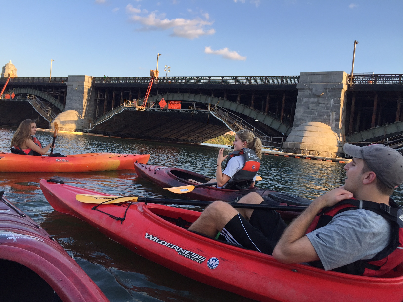 The Boston office spends a happy hour kayaking on the Charles River